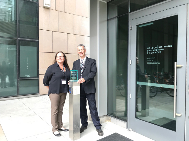 Carrie Sinclair & Trevor Thornton outside the Molecular Nano Engineering and & Sciences building, at the University of Washington, where the award was presented.
